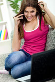 Smiling girl talking on phone and looking in commuter — Stock Photo