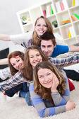 Group of teenagers having fun indoor — Stock Photo