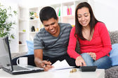 Couple doing their accounts — Stock Photo