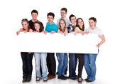 Smiling young friends blank sing — Stock Photo