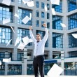 Businessman throwing paperwork — Stock Photo #10634694