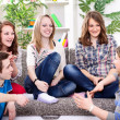 Young girl talking with her friends - Foto Stock