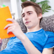 Stock Photo: Teenager boy reading book