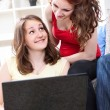 Young girls using laptop — Stock Photo
