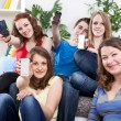 Teenagers showing mobile phones' screen — Stock Photo