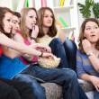Постер, плакат: Teenagers watching TV