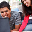 Stock Photo: Loving couple working on a laptop together