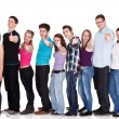 Group of smiling friends standing in row — Stock Photo