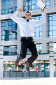 Happy businessman jumps in the air — Stok fotoğraf