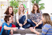 Young girl talking with her friends — Stock Photo
