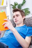 Teenager boy reading book — Stock Photo