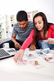 Couple calculating their domestic bills — Stock Photo