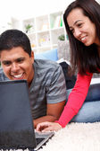 Loving couple working on a laptop together — Stock Photo