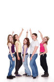 Group of girls pointing to copy — Stock fotografie