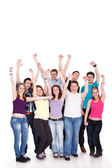 Young joyful teens standing on white background — Stock Photo