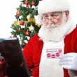 Santa  paying with credit card — Stock Photo