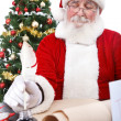 Santa writing Christmas list — ストック写真
