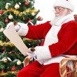 Santa Claus reading wish list — Stock fotografie