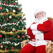 Stock Photo: Santa sitting in rocking chair