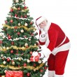 Santa Claus bringing gifts — Stock Photo