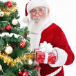 Smiling Santa with present — Stock Photo