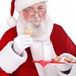 Santa Claus Girl eating cake on plate — Stock Photo