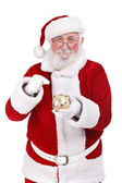 Santa punting piggy bank — Stock Photo