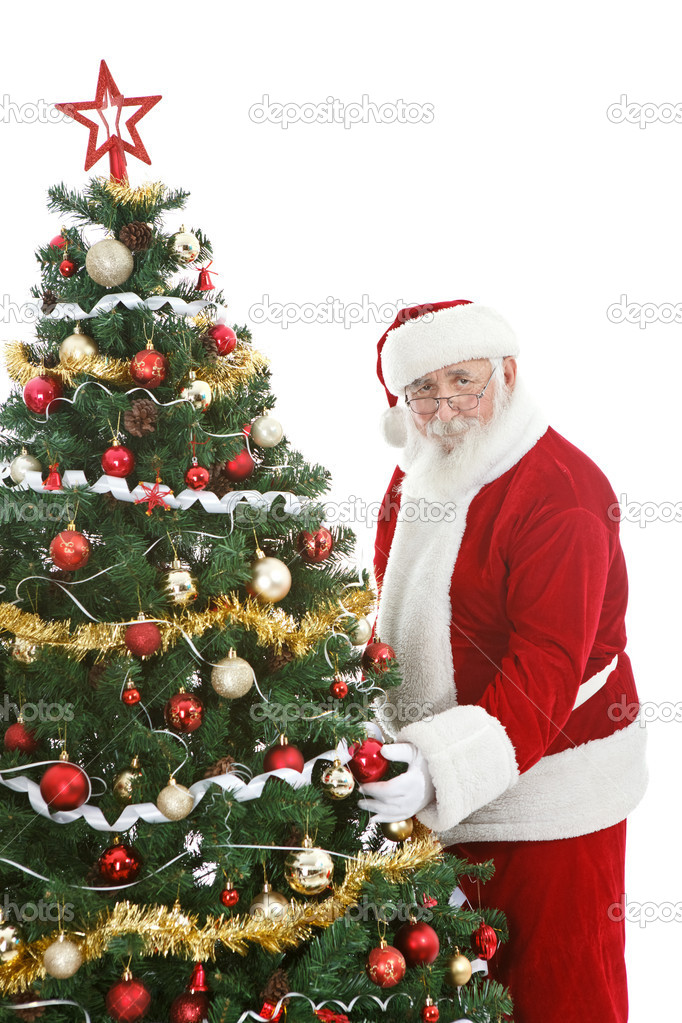 Santa Claus decorating  Christmas tree,  last preparations for Christmas  Stock Photo #8123338