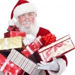 Santa carrying present boxes — Stock Photo #8139731