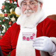Modern Santa with credit card — Stock Photo