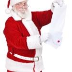Santa reading wishes of children — Stock Photo #8139748