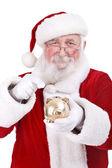 Santa zeigenden sparschwein — Stockfoto