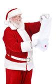 Santa reading wishes of children — Stock Photo