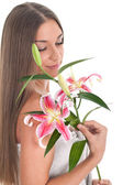 Woman with pink lily — Stock Photo