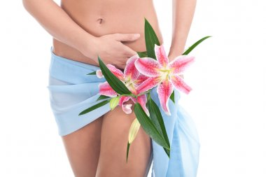 Perfect woman's body with cute flower on her hip