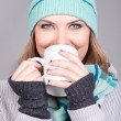Beautiful girl with hot drink — Stock Photo