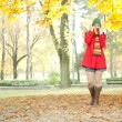 Stock Photo: Young girl in autumn park