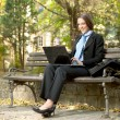 Stock Photo: Smiling businesswomwith laptop