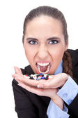 Angry businesswoman holding pills — Stock Photo