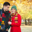 Young couple in cold autumn park — Stock Photo