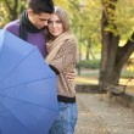 Romantic couple with umbrella — Stock Photo