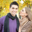 Young couple in love kissing in autumn park — Stock Photo