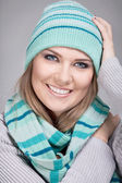 Smiling woman with scarf and hat — Stock Photo