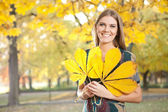Funny girl with autumn leaves — Stock Photo