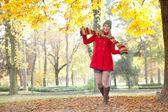 Funny girl in autumn park — Stock Photo