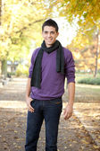 Handsome man posing in autumn park — Stock Photo