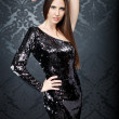 Stock Photo: Girl wearing in sequin black dress