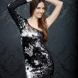 Attractive woman in sequined dress - Stock Photo