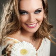 Smiling woman with flower — Stock Photo