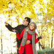 Young couple enjoying in autumn — Stock Photo